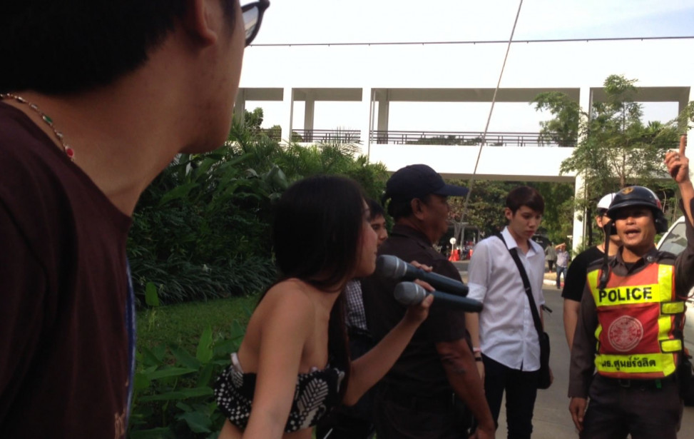 Aum facing the policeman.jpg
